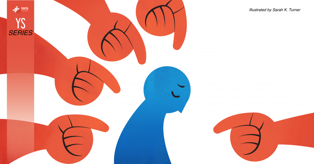 Illustration of five hands pointing to a slumped over, sad figure, representing bullying.